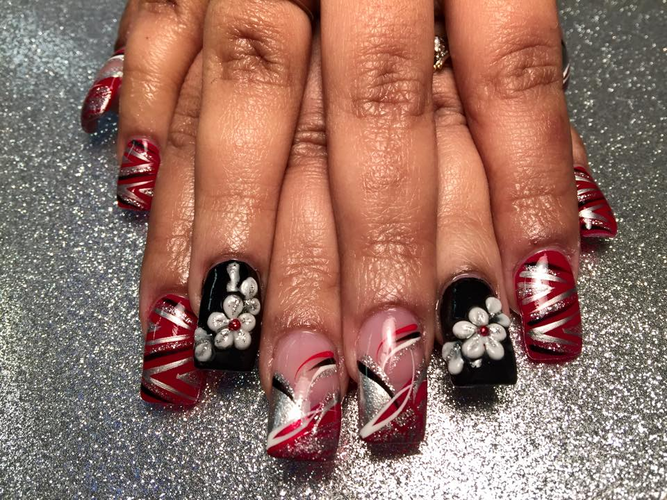 Black nail w white silvery sparkled flower petals red dot or angled