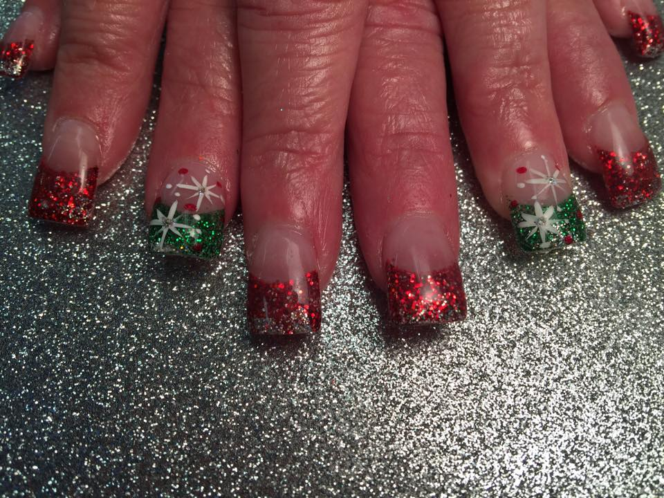 glittery red or green tips with silver sparkles and bethlehem stars with centered diamond glue christmas stars nail designs by top nails - Red And Green Christmas Nails