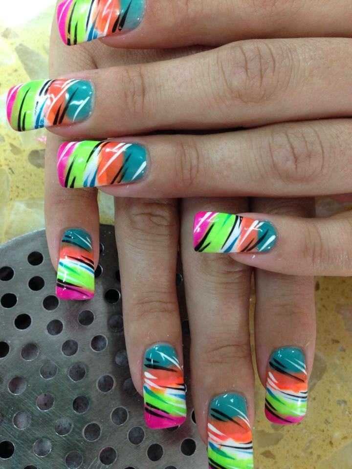 Angled Bright Pink Tip Under Neon Green White Peach And Turquoise Multi Colored Tiger Nail Designs By Top Nails